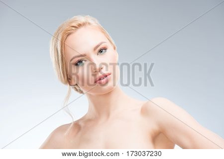 Gorgeous young sensual woman looking at camera body care concept