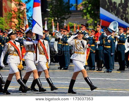 MOSCOW - MAI 9: Banner group of female military unit on the Victory Parade in solemn march on Red Square -  on Mai 9, 2016 in Moscow