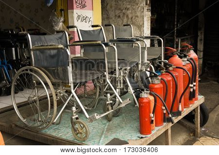 a store selling wheelchairs and fire extinguishers with red tube photo taken in Depok Indonesia java