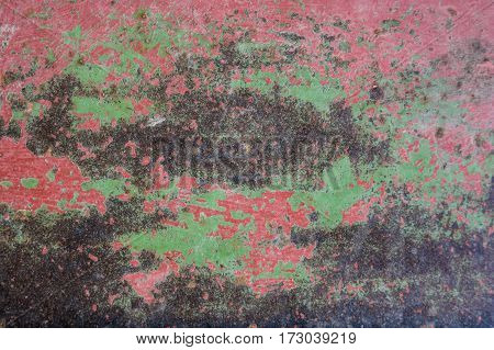 Cracked painted old brown or wine metal surface