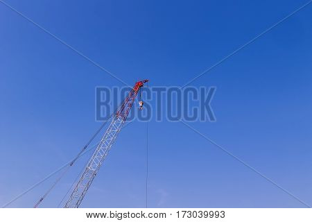 Crane on construction site with cloud and sky