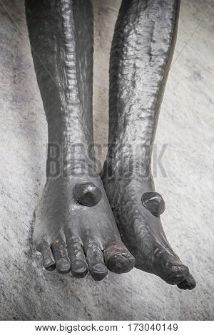 Detail of the feet of Jesus Christ in the Holy Cross