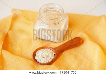 handcarved little wooden spoon in a jar of black chrystal salt