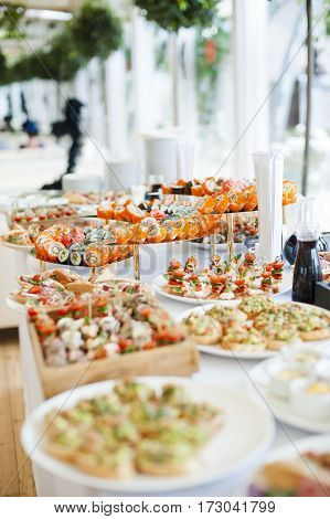 sushi and snacks on a beautiful buffet table food