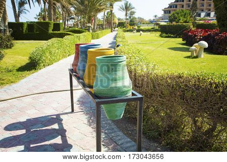 Color containers for sorting of garbage on streets of Egypt