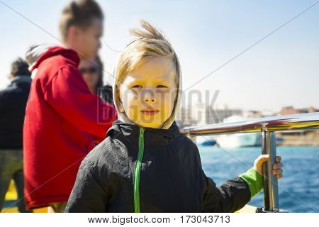 Portrait of the serious little boy onboard the ship
