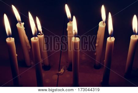 Candle lighted up at night in dark