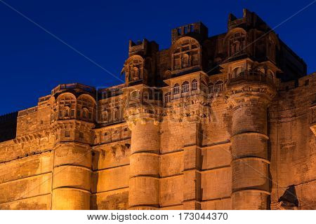 Details Of Jodhpur Fort  Illuminated At Twilight. The Majestic Fort Perched On Top Dominating The Bl