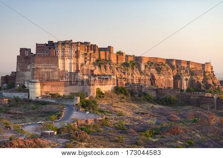Details Of Jodhpur Fort At Sunset. The Majestic Fort Perched On Top Dominating The Blue Town. Scenic