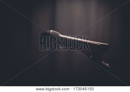 Close up shot of a microphone on a stand.