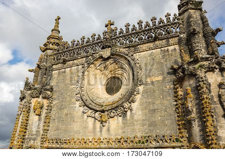 The elaborate pinnacles over the western facade of the church in the Convent of Christ Tomar Portugal