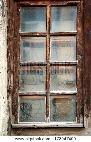 Dusty images on the old grunge wooden window