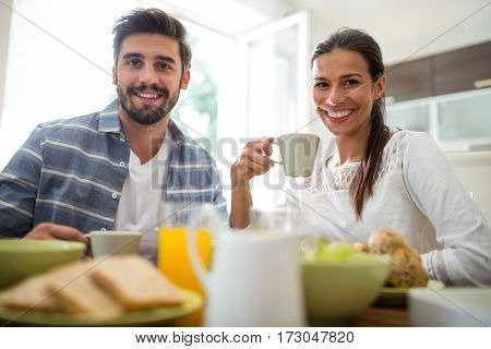 Portrait of couple having breakfast at home