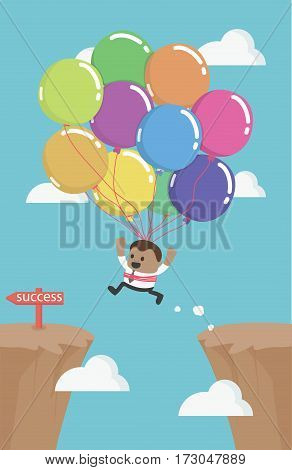 African business man flies across gap to another cliff by using balloon