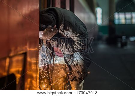 a welder working at the factory industry