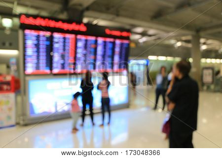 Blurred Image Of Business People In International Airport Terminal, Looking At Information Board, Ch