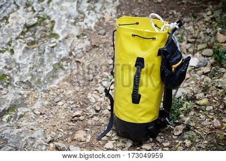 Climbing rope inside a yellow backpack.