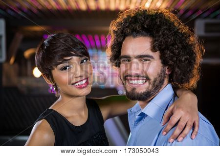 Portrait of romantic couple dancing together on dance floor in bar