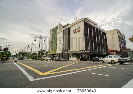 Bandar Seri Begawan,Brunei-Nov 10,2016:View on the main street in Bandar Seri Begawan,Brunei with buildings and a walkway,cars on the road,skyscraper in the background.