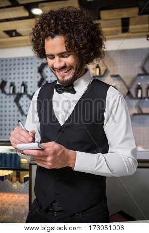 Bartender taking an order in a bar