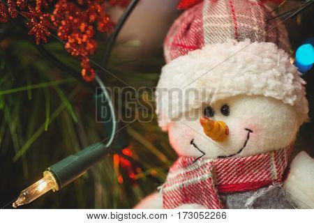 Close-up of snowman hanging on christmas tree during christmas time