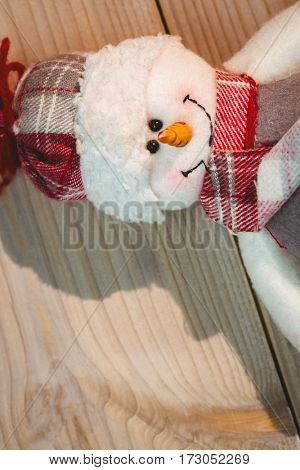 Close-up of snowman on wooden table during christmas time