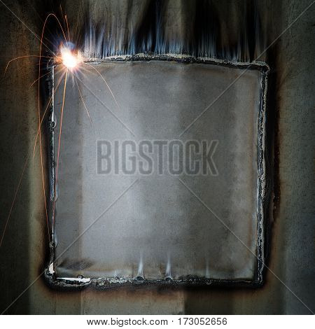 Welding fire and Welding bead from container wall repair grunge metal frame of welding string abstract background