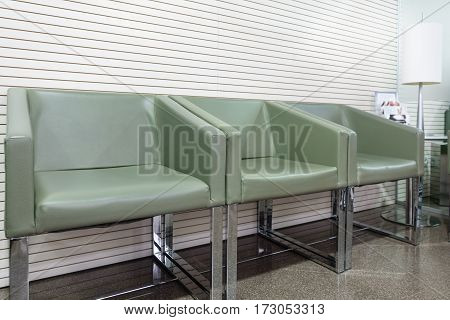 Green chairs in waiting room, perspective view