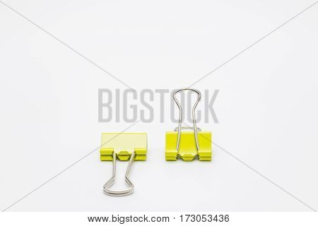 Yellow paper clips isolated on white background Copy space.