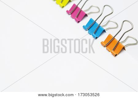 Colorful paper clips isolated on white background Copy space.