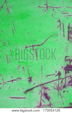 Green rusted metal background and texture. Green grunge old rusty scratched surface texture. Background - old metal surface. Abstract background and texture for designers.