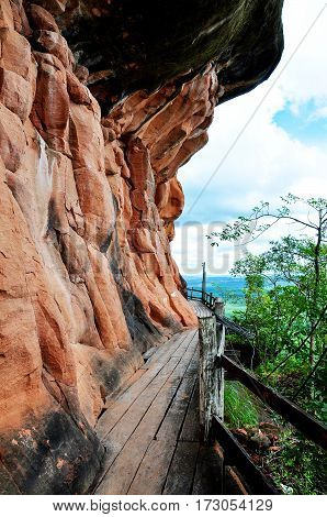 The wooden corridor loop around the sandstone mountain Phu thok temple district Bueng Kan Thailand