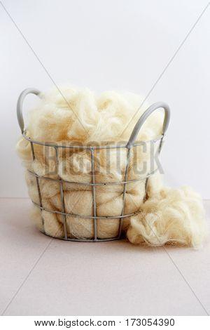 Basket of raw natural fiber.