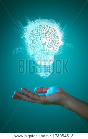 Hands of business person holding illuminated light bulb sign. Concept of new idea