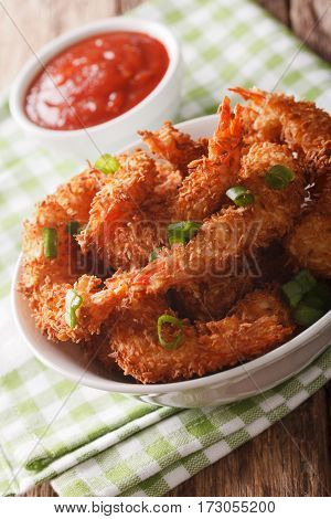 Fried Coconut Shrimp Close Up In A Bowl And Tomato Sauce. Vertical
