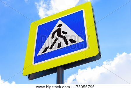 Traffic sign pedestrian crossing against the blue sky background