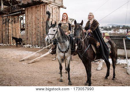 two girls Vikings on horseback. Antiquity, history. Soft light
