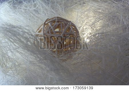 decorative straw ball isolated over the white web, one foreshortening