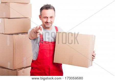 Mover Guy Holding Cardboard Box And Pointing Camera