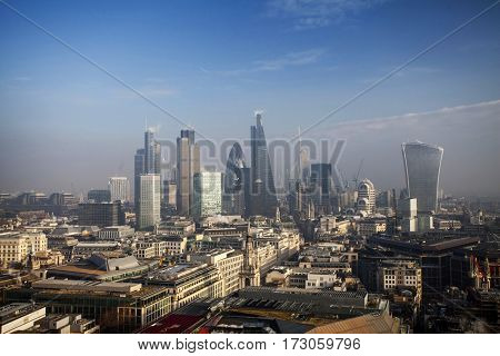 City of London, business and banking aria. Rooftop view over London on a foggy day from St Paul's cathedral, UK