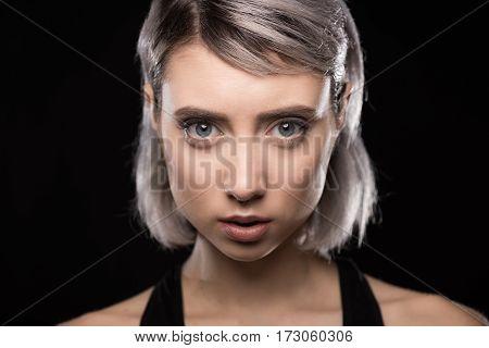 Attractive young woman with beautiful big eyes looking at camera