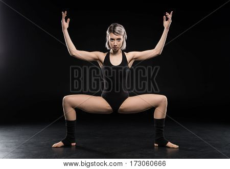 Attractive young woman contemporary dancer posing and looking at camera