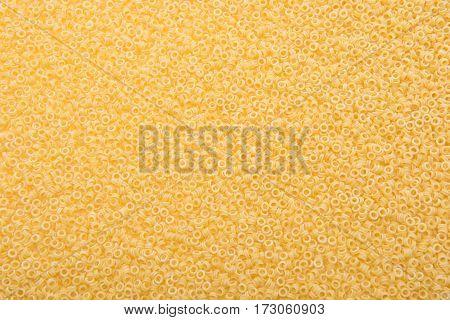 full frame of raw macaroni for making pasta as background