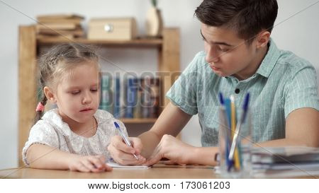 Teenager and girl learning on white background