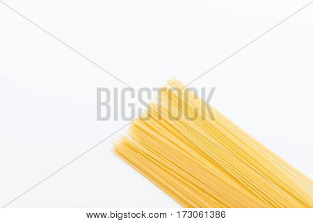 Top view of raw vermicelli for making pasta on white
