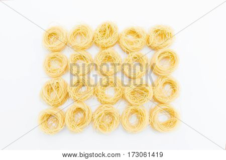Classical uncooked italian pasta isolated on white
