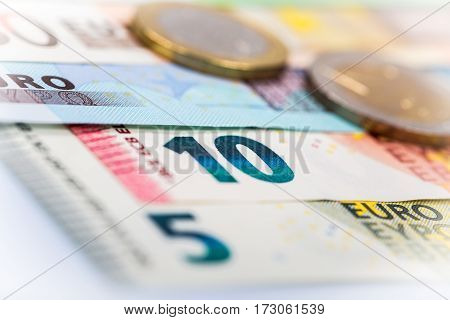 Closeup Of Banknotes And Coins