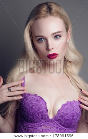 Beauty Model Girl With Perfect Make-up Red Lips And Blue Eyes Looking At Camera, Wearing Magenta Bra
