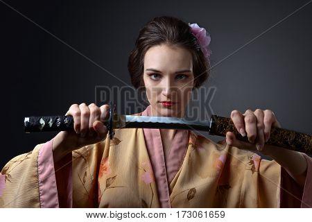 Beautiful Woman In Traditional Japanese Kimono With Katana