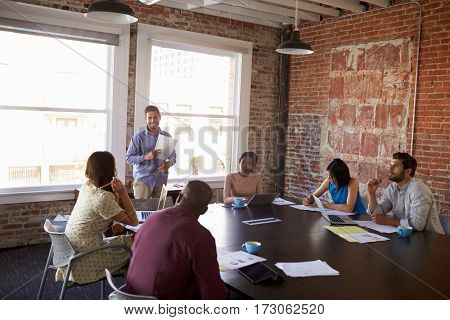 Businessman Standing To Address Boardroom Meeting